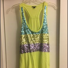 Tank top Yellow/green glitter top. Only wore once, bigger at the bottom of the shirt! Express Tops Tank Tops