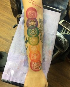 Yogis will love this colorful chakra tattoo.