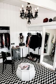 Fantastic bedroom converted into dressing room with white wood paneled walls and ceiling accented with shoes placed on black tray tucked under rolling clothes rod. Description from pinterest.com. I searched for this on bing.com/images