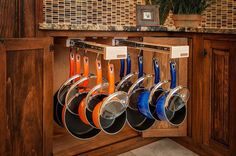 Store your pans on these genius slide-out racks. | 42 Storage Ideas That Will Organize Your Entire House