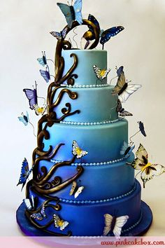 Beautiful #Blue shades 5 Tier #Wedding #Cake with gorgeous #Butterflies We love and had to share! Great #CakeDecorating! #Bridal #Nuptials #Celebstylewed
