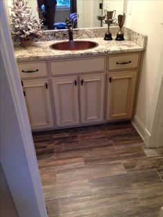 The bathroom! wood like tile flooring, tile Wood Like Tile Flooring, Wood Look Tile, Basement Flooring, Tile Wood, Wood Bathroom, Bathroom Ideas, Bathroom Cabinets, Bath Ideas, Bathroom Faucets