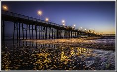 """""""Golden Moment""""    The lights reflected from the Oceanside Pier looks like gold dancing on the water in Oceanside, California. Photo by Paul W. Koester"""