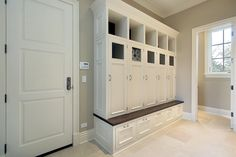 Mini mudroom corner storage bench with small individual drawers under it. Also there are five closed storage lockers  and five opened storage lockers .