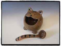 Cute tabby cat Salt Pig - looks like it could be the cheshire cat with that smile - I love the tabby stripes on the matching spoon