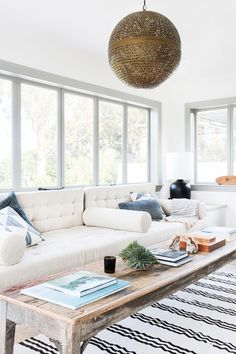 If you're looking to spice up a room with Moroccan influence and all-around boho vibes, perforated metal can provide just the right worldly texture. In this bright and clean sunroom, the tarnished brass finish and perforation give the pendant a beachy, breezy look that sets it apart from sleeker and shinier styles