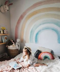 Adorable kids room! Love that rainbow wall.
