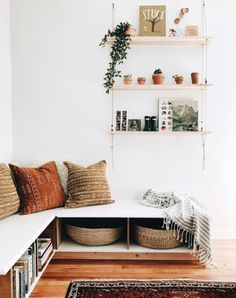 built-in bench with storage and hanging shelves overhead. / sfgirlbybay