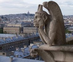 "Notre Dame -- not my photo but have this exact one (and one of a different gargoyle ""eating"" a dome :P )"