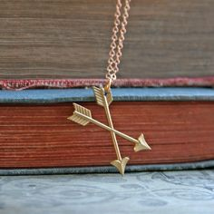 Double arrow cross pendant hangs on a vintage brass chain. Size of charm is about 1 inch. The length of chain is 17 inches. Give it to someone