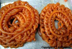 Jeri, also known as jalebi or jilphi, are one of the most common sweets in Nepal. They are deep-fried, pretzel-shaped yellow-orange loops dipped in saffron syrup. Jeri tastes best when freshly made as they are crisp and the filling is succulent and aromatic. The next day, jeri looses their crispiness, and the filling crystallizes, but they are still delicious. Traditionally, jeri are paired with soft Nepali bread called swaari.