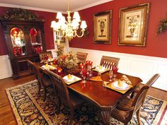 love this red dining rooms--black chairs, venetian mirror, white