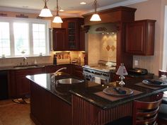 Cherry kitchen cabinets with Uba tuba granite countertops