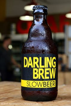 Darling Brew's Slow Beer is a refreshing lager with a real hops flavor and rounding off with a mild bitterness. Beer Industry, African Crafts, Bitterness, Rounding, Craft Beer, Brewery, Beer Bottle