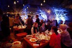 Customers have dinner at the Muru Pop Down restaurant at the Tytyri mine in Lohja, Finland.