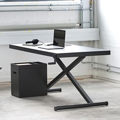 Shop SUITE NY for the X Table designed by Kibisi for Product Partners and more modern furniture including designer height adjustable work desks.