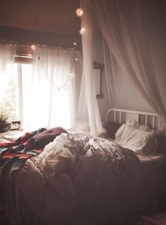 Love the white comforter with colorful blanket.