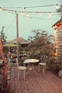Bistro lights on back patio Outdoor Rooms, Outdoor Gardens, Outdoor Living, Outdoor Decor, Small Brick Patio, Brick Patios, Dream Garden, Home And Garden, Bistro Lights