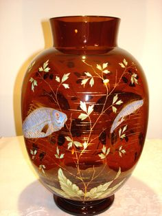HARRACH BROWN GLASS VASE WITH ENAMELED FISHES AND PLANTS. Circa 1890 www.madforglass.com Glass Collection, Vases, Flower Arrangements, Roman, Glass Art, Pottery, Ceramics, Flowers, Plants