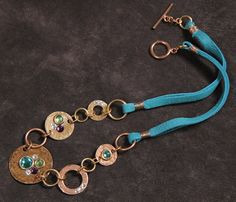 Baubles and Bling mixed media necklace: hammered by StudioEgallery