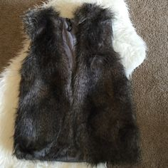 Jessica Simpson Faux Fur Vest with Hood Super cute faux fur vest with hood. Still in perfect condition! ❌ No Trades 🔵 please use offer button Jessica Simpson Jackets & Coats Vests