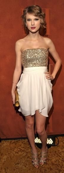 Dress – Alice + Olivia, Shoes – Jimmy Choo, Purse – Christian Louboutin (may 2010)