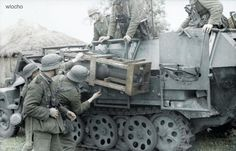 German troops from the 27th Panzer Div. Looks like they are adjusting a (halftrack mounted) rocket system for elevation. ✠