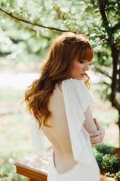 Katie May backless wedding dress // a&be bridal shop  photographer levi tijerina photography • florist lalé florals venue river bend and lyons farmette {lyons, co} • stylist emily smoot hair matthew morris salon • make-up alchemy mineral blends