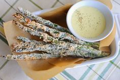 """Baked parmesean asparagus """"fries"""" with aioli dipping sauce :)   Made these last night and used the extra ingredients and the same method with some eggplant slices, both came out amazingly delicious!! :)"""