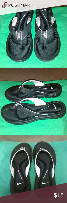 Women's Nike Flip Flops These are Nike women's flip flops. They are a size 10W but fit like a size 9 regular. They are used. Nike Shoes Sandals