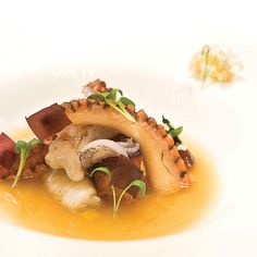 """Adam Handling, Head Chef at Adam Handling at Caxton in St James's Park, gives you a recipe for pork belly, octopus, squid, and mussel consommé, from his recently published first recipe book, """"Smile or Get Out of the Kitchen"""""""