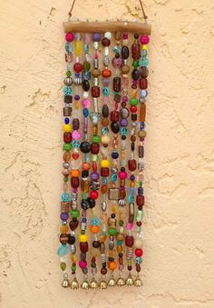 Beaded Wind Chime and Suncatcher on Mesquite with Bells Garden Art -- via Etsy