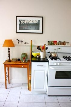 quirky kitchen with the horse ornaments and lamp on small wooden side table