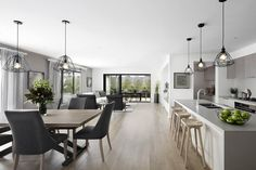 The Barcelona 32 by Boutique Homes Vic #weeklyhometrends #boutiquehomes #newhome #newbuild #displayhome #kitcheninspo #interiors #design #styling #pendantlights #kitchenstools #timber #greytones #calmingcolourpalette #dining #openplanliving   http://www.boutiquehomes.com.au/home-design-group/barcelona