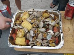 Several months ago, K threw me a birthday party on a beach in Carmel By The Sea and decided to make what I've always wanted to try – a clam bake! Now, this isn't your usual clam bake wh… Clam Recipes, Entree Recipes, Grilling Recipes, Seafood Recipes, Cooking Recipes, Shellfish Recipes, Seafood Bake, Grilled Seafood, Seafood Dishes
