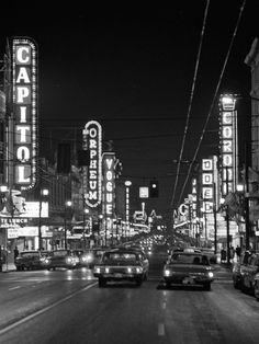 Neon signs line Granville St., Vancouver, BC - 1965