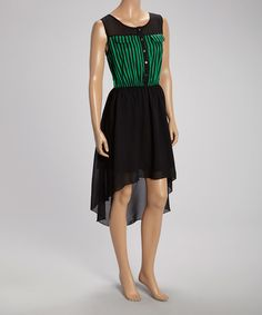 Slip+into+style+with+this+lovely+dress.+Thin+stripes+and+playful+pockets+jazz+up+the+bodice,+while+a+hi-low+hem+adds+on-trend+appeal.