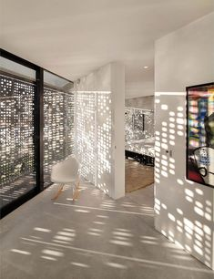 The perforated outdoor screen creates a beautiful light reflection on the indoor plaster walls - Villa Kavel 1 near Amsterdam The Netherlands by Studioninedots