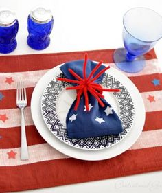 Using the American flag as inspiration, take a red placemat and paint white stripes using painter's tape as a guide.