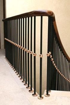 Bright steel balustrade with polished brass turnings and hardwood handrail Staircase Interior Design, Staircase Railing Design, Interior Stair Railing, Modern Stair Railing, Staircase Handrail, Balcony Railing Design, Stair Decor, Modern Staircase, Balustrade Design