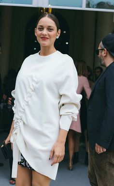 Marion Cotillard spotted on the street at Paris Fashion Week. Photographed by Phil Oh.