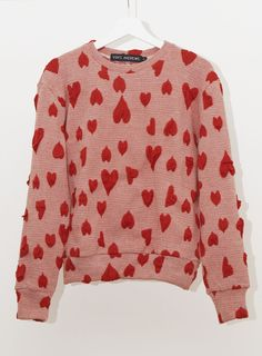 The product ALLOVER HEARTS JUMPER is sold by Vinti Andrews in our Tictail store.  Tictail lets you create a beautiful online store for free - tictail.com