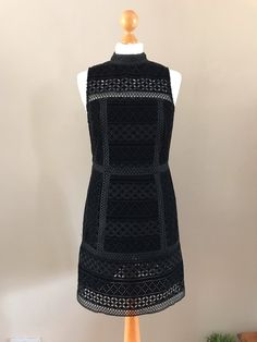 7bd68e86a2b0b3 Gorgeous black velvet embroidered shift dress with high neck detail. A real  head turner and