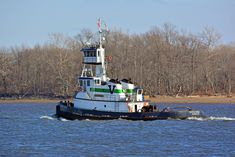 Tugboat Oyster Creek, out of Baltimore, chugging upstream past Riverton, NJ, on the Delaware River.