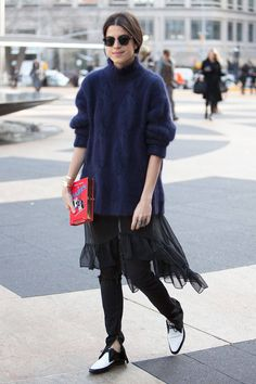 Leandra Medine rocking a sweater over a dress over pants at NYFW Fall/Winter 2014