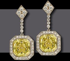Hand made Platinum and 18 kt yellow gold drop earrings  containing two matched Fancy Yellow radiant cut diamonds,  one 5.35 ct VVS1 and one 5.54 ct Internally Flawless  surrounded by approximately 1 ct of fine white brilliant cuts