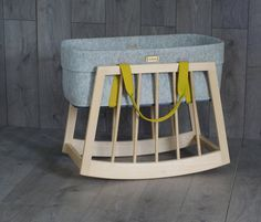 Moses basket rocker with wool mokee nest| Repinned bywww.thebonniemob.com: British designed unisex baby and kids fashion clothing brand for stylish little ones. The bonnie mob ship worldwide from the UK.
