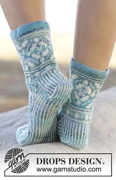 "Ice Magic - Knitted DROPS socks with Norwegian pattern in ""Fabel"". Size 35 - 43 - Free pattern by DROPS Design Knitting Charts, Knitting Stitches, Knitting Patterns Free, Free Knitting, Free Pattern, Knitted Slippers, Knit Mittens, Knitting Socks, Ice Magic"