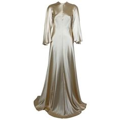 Pre-owned Lanvin 1970s Couture Ecru Silk Goddess Gown ($9,500) ❤ liked on Polyvore featuring dresses, gowns, brown, evening gowns, white evening gowns, white dress, silk gown, white bell sleeve dress and couture dresses