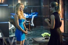 Again!!! so lovely with the black dress - from the season 3E5 secret origin of felucity smoak together with mama donna smoak, i can see wher her fashion came from